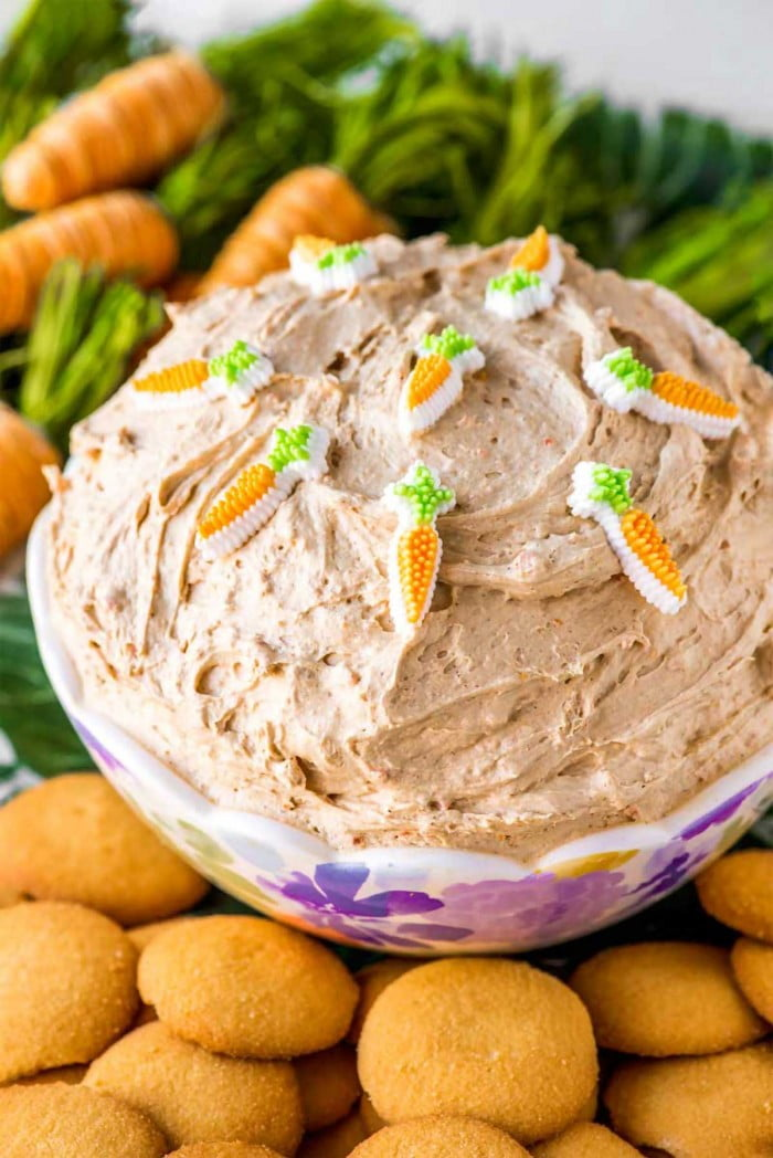 Carrot cake batter dip served in a festive bowl with nilla wafers.