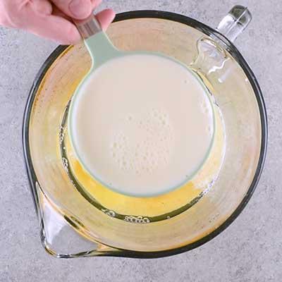 Coffee Creamer French Toast Casserole Step 1 - Add milk.
