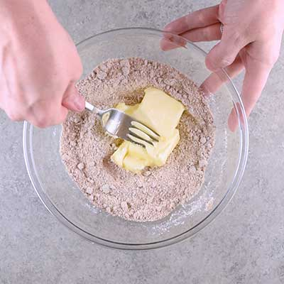 Coffee Creamer French Toast Casserole Step 4 - Mash butter into dry ingredients.