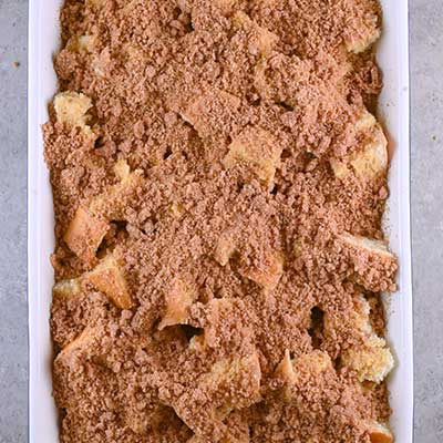 Coffee Creamer French Toast Casserole Step 5 - Sprinkle crumble over French toast.
