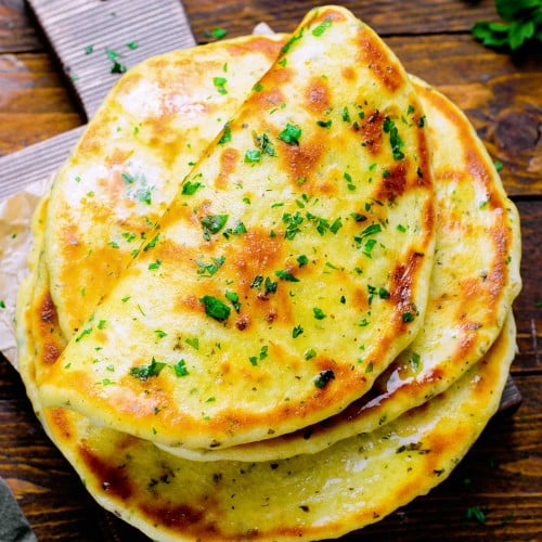 Easy homemade flatbread flavored with herbs and garnished with parsley.