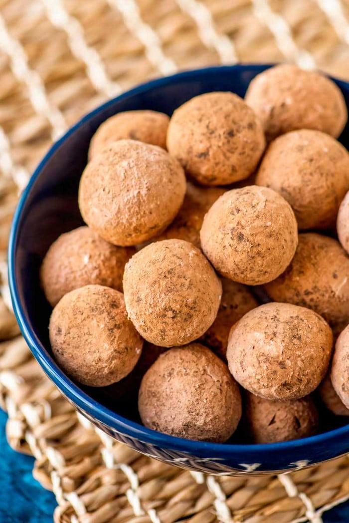Kentucky bourbon balls coated in powdered chocolate sugar.