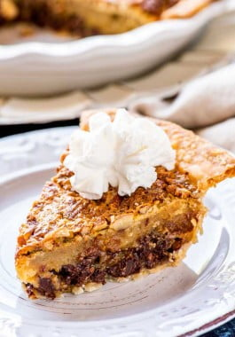Plated kentucky bourbon pie with whipped cream on top.