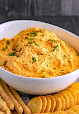 Blended pinto cheese spread served with crackers.