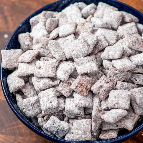 Homemade puppy chow made with Chex cereal, chocolate, and sugar.