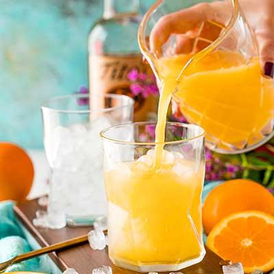 Screwdriver Cocktail Step 1 - Add orange juice.