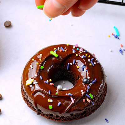 Baked Chocolate Cake Donuts Step 7 - Decorate donuts with sprinkles.