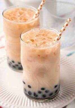 Boba milk tea with tapioca pearls in a tall glass.