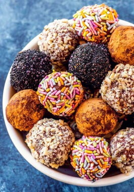 Decorated chocolate truffles in a bowl.