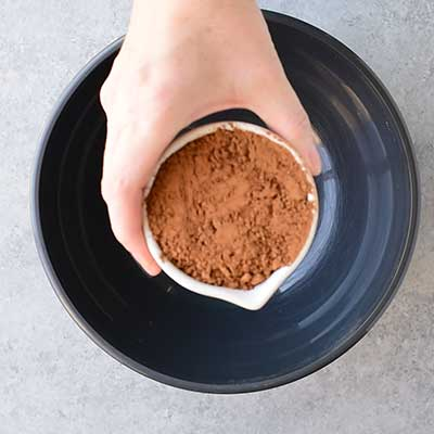 Cookie Dough Whoopie Pies Step 1 - Add cocoa powder to a bowl.