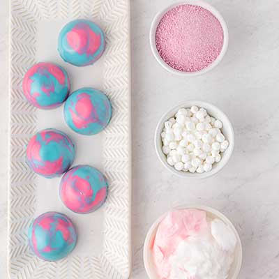 Cotton Candy Hot Chocolate Bombs Step 7 - Arrange prepared hot chocolate bombs and filling.