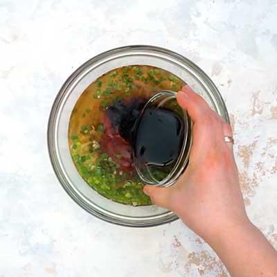 Crock Pot Bourbon Chicken Step 1 - Add soy sauce.