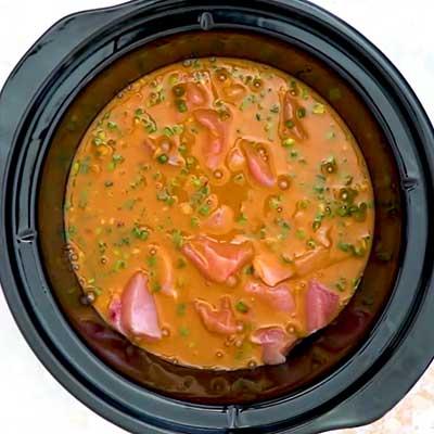Crock Pot Bourbon Chicken Step 2 - Pour sauce on top.