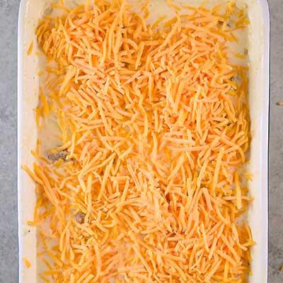 Italian Sausage and Potato Casserole Step 5 - Cover casserole in cheddar cheese.