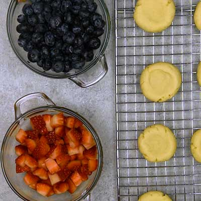 Patriotic Fruit Pizza Cookies Step 7 - Arrange baked cookies with fruit nearby.