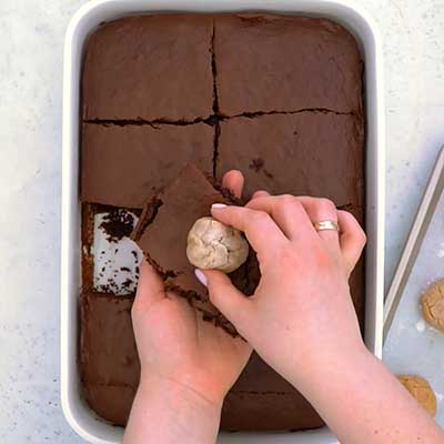 Peanut Butter Brownie Bombs Step 4 - Place peanut butter filling in center of brownie.