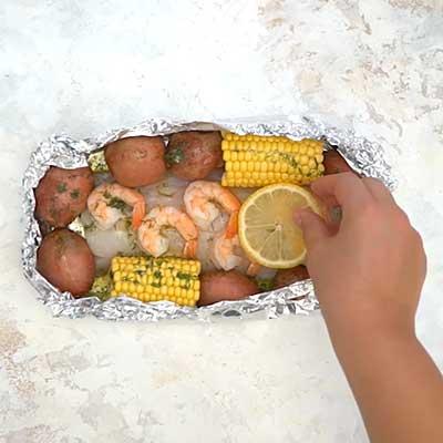 Seafood Boil Foil Packets Step 3 - Add sliced lemons on top.