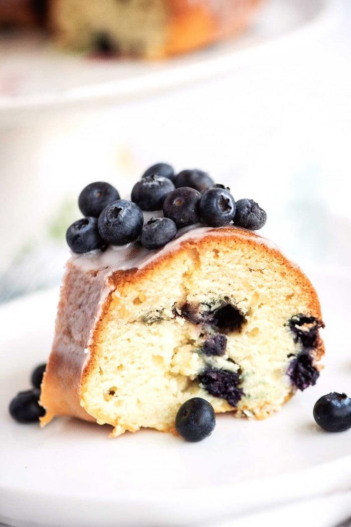 Side view of slice of blueberry bundt cake.