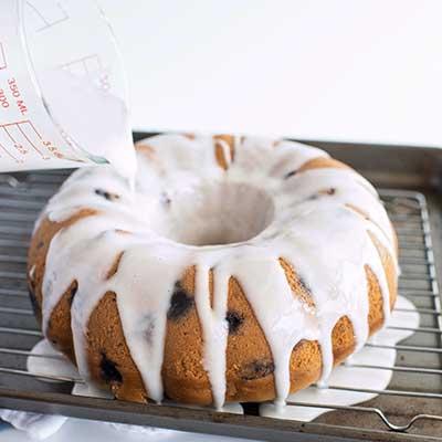 Blueberry Bundt Cake Step 8 - Pour glaze over baked bundt cake.