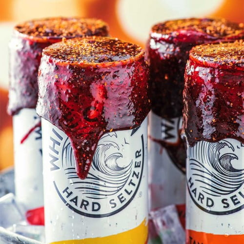 Homemade chamoy rim paste on cans of white claw.