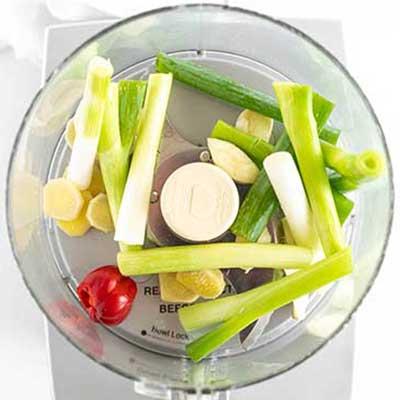 Jerk Chicken Skewers Step 1 - Add scallions, garlic, ginger, and scotch bonnet pepper to food processor.
