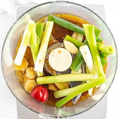 Jerk Chicken Skewers Step 1 - Add lime juice, soy sauce, and vegetable oil.