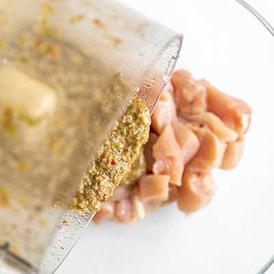 Jerk Chicken Skewers Step 2 - Pour marinade on chicken.