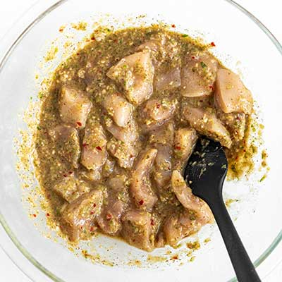 Jerk Chicken Skewers Step 2 - Toss chicken in marinade.