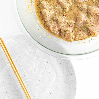 Jerk Chicken Skewers Step 4 - Grab skewers and marinated chicken.