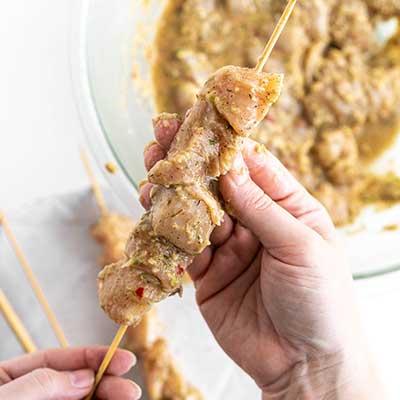 Jerk Chicken Skewers Step 4 - Thread chicken on skewers.