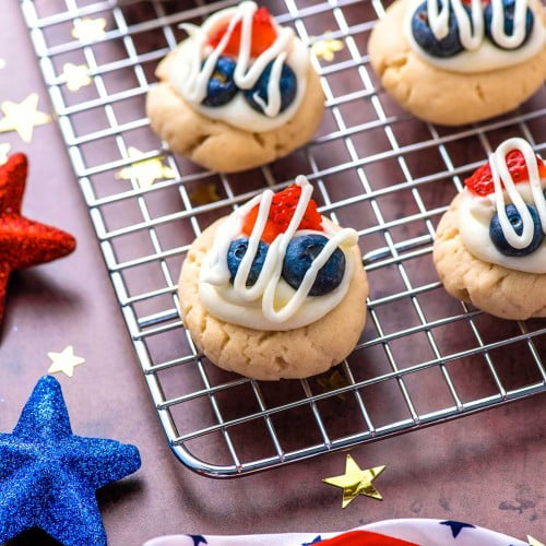 Red, White, and Blue fruit cookies on a baking sheet with star decorations.