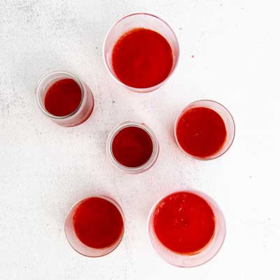 Red, White, and Blue Layered Jello Step 1 - Pour liquid red jello into chosen serving containers.