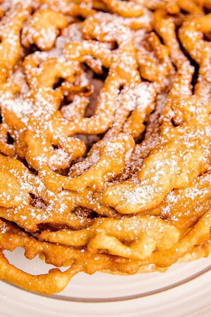Close up view of lines in funnel cake topped with powdered sugar.