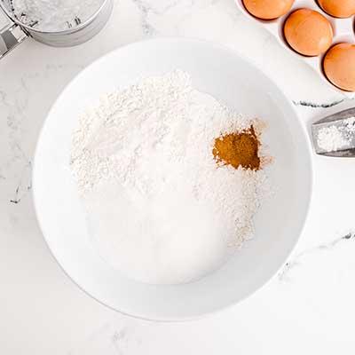Homemade Funnel Cakes Step 2 - Add flour, sugar, baking powder, cinnamon, and salt to a bowl.