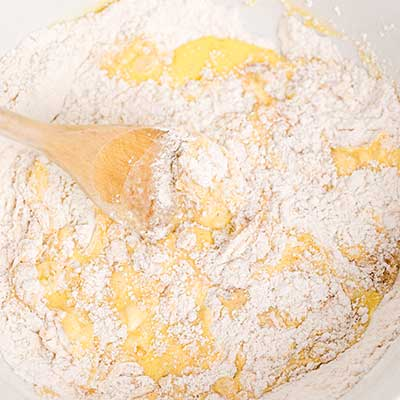 Homemade Funnel Cakes Step 3 - Mix wet and dry ingredients together.