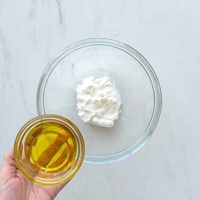 Greek Chicken Skewers Step 1 - Add olive oil.