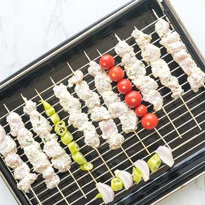 Greek Chicken Skewers Step 4 - Thread chicken on skewers.