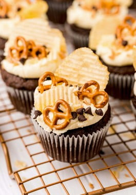 Kitchen sink cupcakes topped with pretzels, potato chips, and chocolate chips.