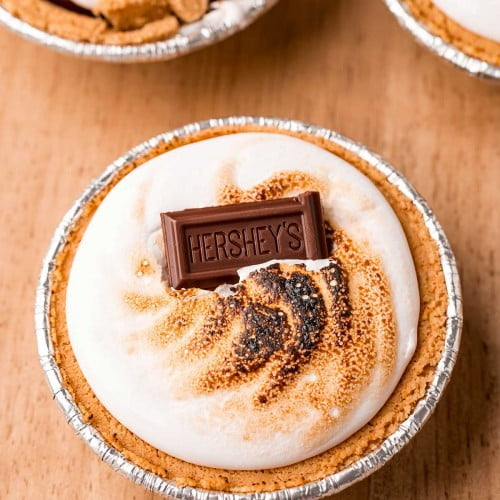 S'mores pies with roasted marshmallow and topped with a Hershey bar.