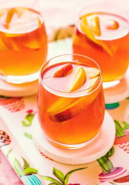 Glasses filled with peach sangria.