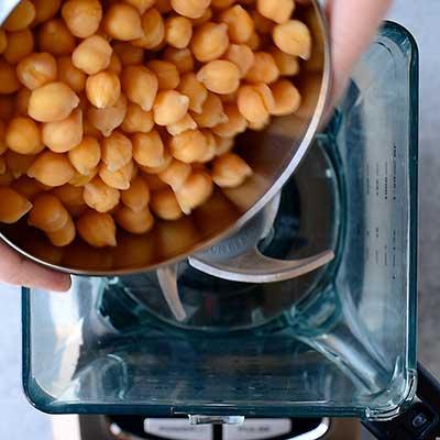 Roasted Beet Hummus Step 3 - Add chickpeas to food processor.
