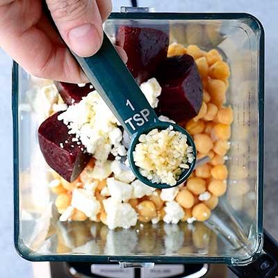 Roasted Beet Hummus Step 3 - Add garlic.