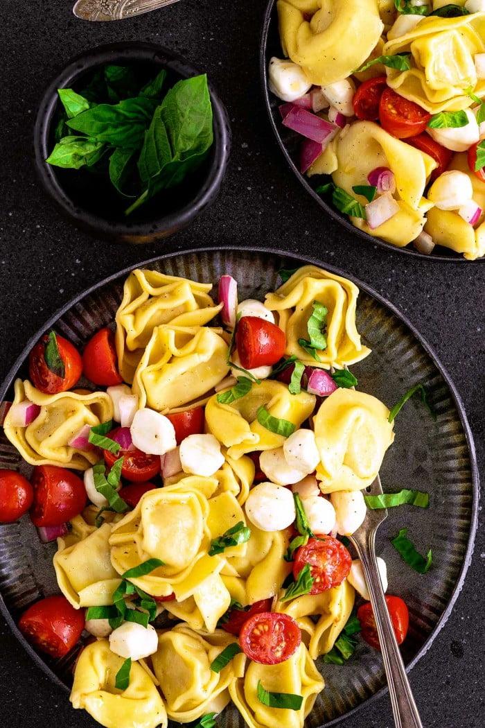 Tortellini pasta salad served on a plate.