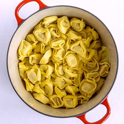 Tortellini Pasta Salad Step 1 - Drain pasta and rinse with cool water.
