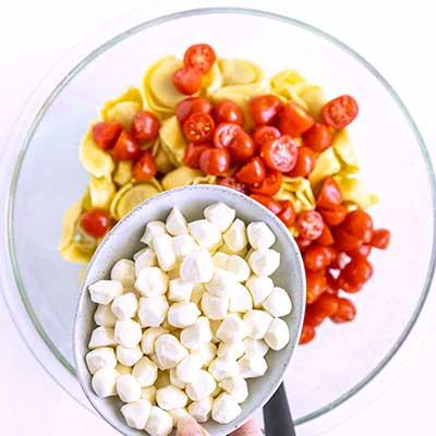 Tortellini Pasta Salad Step 3 - Add mozzarella pearls.