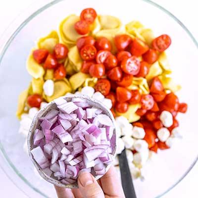 Tortellini Pasta Salad Step 3 - Add red onion.